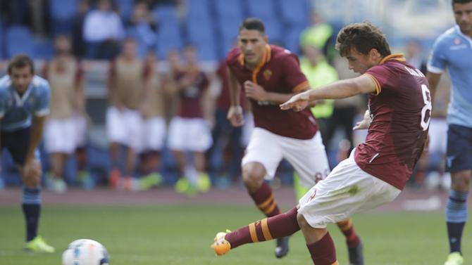 AS Roma forward Adem Ljajic of Serbia scores on a penalty kick during a Serie A soccer match between As Roma and Lazio, in Rome's Olympic stadium, Sunday, Sept. 22, 2013. AS Roma won 2-0