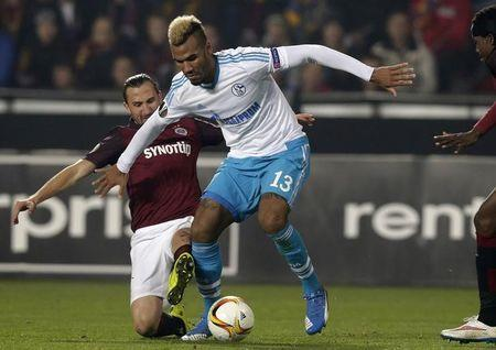 Sparta Prague's Jiracek fights for the ball with Schalke 04's Choupo-Moting during their Europa League soccer match in Prague