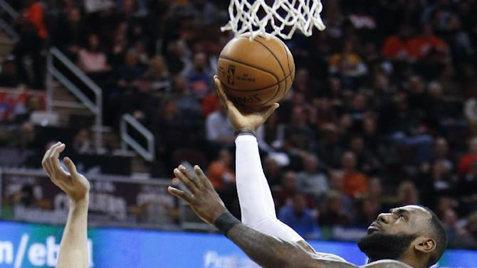 Cleveland Cavaliers' LeBron James (23) scores over Charlotte Hornets' Cody Zeller (40) during the first half of an NBA basketball game Saturday, Dec 10, 2016, in Cleveland. (AP Photo/Ron Schwane)