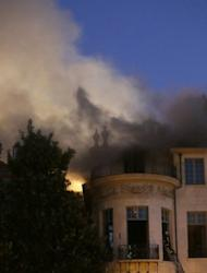 Firemen fight a blaze at the 17th century Hotel Lambert in Paris on Wednesday. Its acquisition by the Qatari royal family, which enjoys strong diplomatic ties with France, sparked a dispute as heritage activists feared they would destroy a cultural gem
