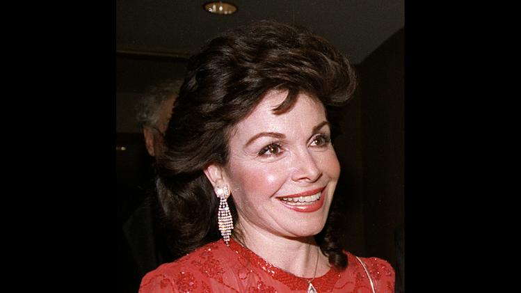 FILE - In this Oct. 20, 1990 file photo, actress and former Mickey Mouse Club member Annette Funicello arrives for the 15th annual Italian American Foundation dinner in Washington. Walt Disney Co. says, Monday, April 8, 2013, that Funicello, also known for her beach movies with Frankie Avalon, has died at age 70. (AP Photo/J. Scott Applewhite, File)