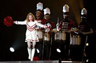 "US pop icon Madonna performs on stage during her first ever concert in the Gulf as part of her MDNA world tour at Abu Dhabi's Yas Island Stadium. An estimated 25,000 fans cheered and screamed as the Material Girl finally appeared on stage more than two hours late, wearing a skin-tight black outfit from her ""Girl Gone Wild"" album"