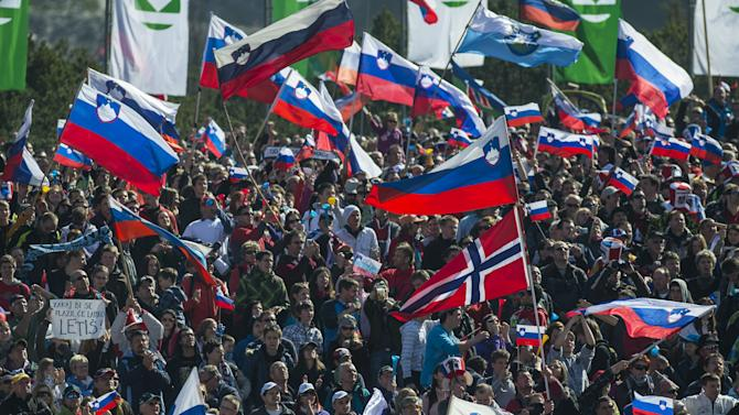 Supporters wave flags during the FIS Ski Flying World Cup Team event in Planica on March 17, 2012.   AFP PHOTO / Jure Makovec (Photo credit should read Jure Makovec/AFP/Getty Images)