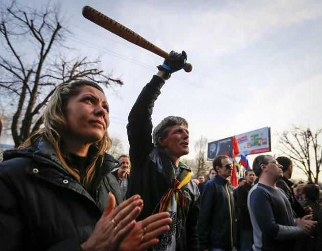 Pro-Russian protesters attend a rally in front of the seized office of the SBU state security service in Luhansk