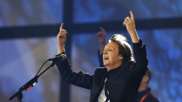 Paul McCartney performs during the Opening Ceremony at  the 2012 Summer Olympics, Saturday, July 28, 2012, in London. (AP Photo/Matt Dunham, Pool)