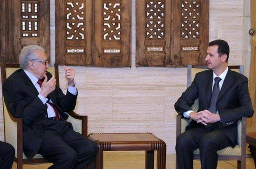 """Syrian President Bashar al-Assad (R) meets with peace envoy Lakhdar Brahimi in the capital Damascus, December 24, 2012. Brahimi held """"constructive"""" talks in Syria with Assad, as Washington warned that his regime's days are numbered."""
