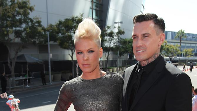 Pink, left, and Carey Hart arrive at the MTV Video Music Awards on Thursday, Sept. 6, 2012, in Los Angeles. (Photo by Matt Sayles/Invision/AP)