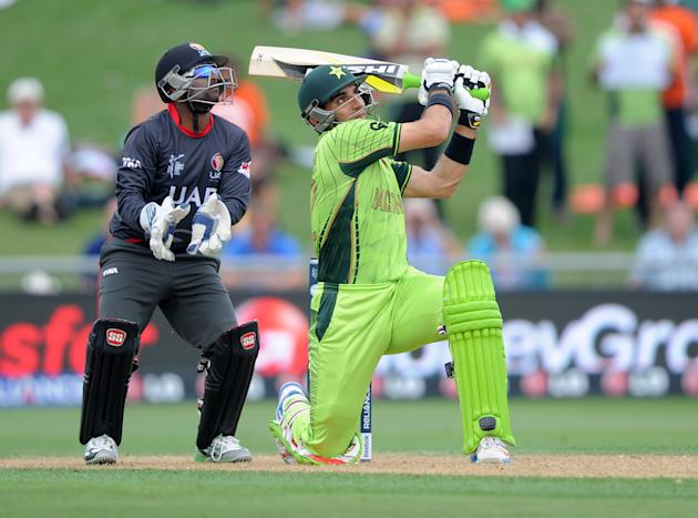 Pakistan's Misbah Ul Haq plays a shot as United Arab Emirates wicketkeeper Swapnil Patil  watches during their Cricket World Cup Pool B match in Napier, New Zealand, Wednesday, March 4, 2015. (AP