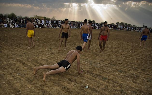 Pakistani kabaddi players get ready for bouts in Gujar Khan, Pakistan, Monday, March 17, 2014. Kabaddi, mostly popular in Pakistan's rural areas, is a traditional sport that combines the character