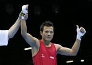 Devendro Singh Laishram of India is declared winner after stopping Bayron Molina Figueroa of Honduras in the first round of their first round Light Flyweight (49kg) boxing match of the London 2012 Olympic Games at the ExCel Arena in London