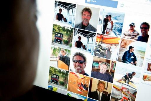 A woman viewing a facebook page belonging to John McAfee(pictured). Belize Prime Minister Dean Barrow on Wednesday urged anti-virus software pioneer John McAfee, wanted for questioning in the murder of a neighbor, to turn himself in to Belizean authorities.