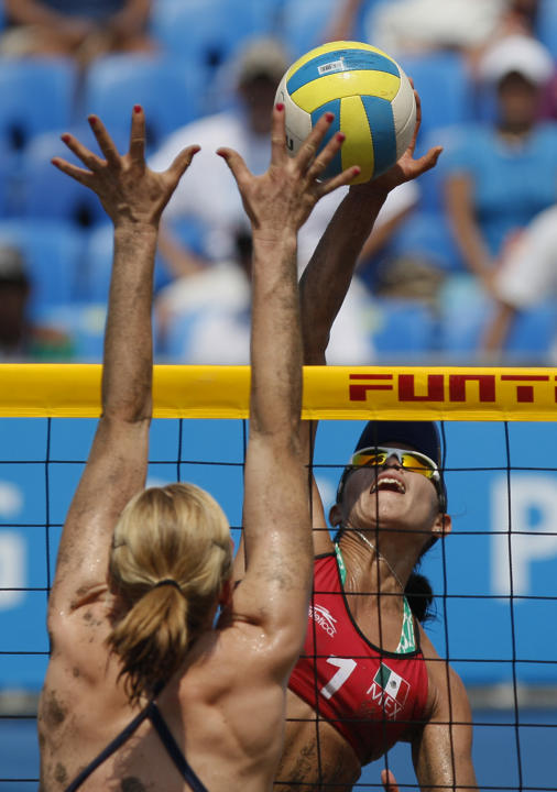 Mexico's Mayra Garcia, right, reaches for the ball during a women's beach volleyball semifinal match against the United States at the Pan American Games in Puerto Vallarta, Mexico, Thursday Oct. 20, 2