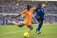 Gervais Kouassi Gervinho (L) of Ivory Coast dribbles the ball against Erasto Nyoni of Tanzania on June 16, 2013 during their 2014 World Cup qualifying match in the Tanzanian capital Dar es Salaam. Egypt, Ethiopia and Ivory Coast Sunday became the first countries to reach the play-offs in the Africa zone of the 2014 World Cup qualifiers