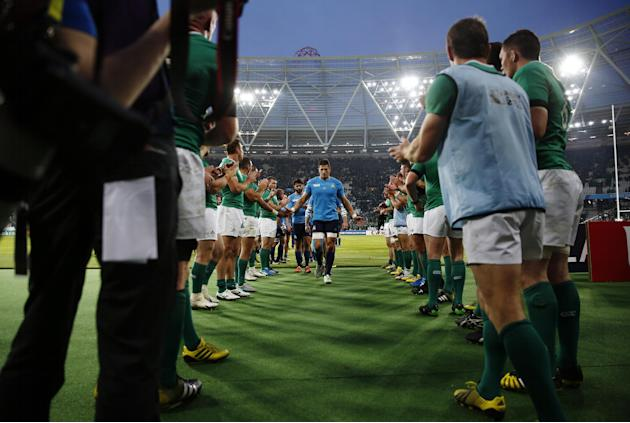 Italy's Alessandro Zanni walks off the pitch dejected at the end of the match as Ireland players applaud
