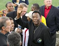 Brazilian football star and former Cosmos player Pele waves to the crowd before the New York Cosmos game at Hofstra University in Hempstead, New York, on August 3, 2013. Pele was joined by fellow 1970 World Cup winner Carlos Alberto, as well as former team-mate and US international Shep Messing