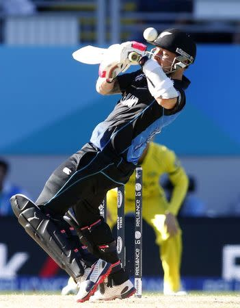 New Zealand's Brendon McCullum plays the ball off his helmet against Australia in their Cricket World Cup match in Auckland