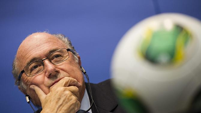 FIFA President Sepp Blatter listens during a news conference following the FIFA Executive Committee meeting in Zurich, Switzerland, Friday, Oct. 4, 2013. Blatter said a final decision on which months to play the 2022 World Cup in Qatar might be delayed until 2015