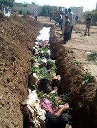 A handout picture of bodies in a mass grave in Daraya of people said to have been killed by regime forces. Fighting took place on Friday in Daraya, which President Bashar al-Assad's forces have been trying to retake for weeks, a watchdog says
