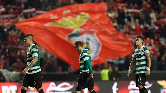 Sporting's Marcos Rojo, from Argentina, Diego Capel, from Spain, and Montero, from Colombia, from left to right, walk on the pitch after the end of their Portuguese league soccer match with Benfica Tuesday, Feb. 11 2014, at Benfica's Luz stadium in Lisbon