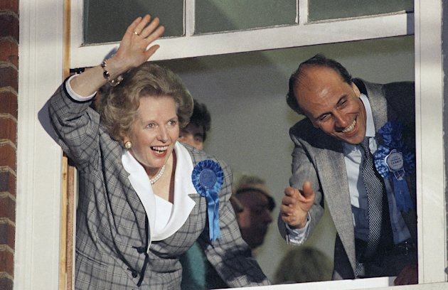 Margaret Thatcher waves to supporters from Conservative Party headquarters in London after claiming victory in Britain's general election, June 12, 1987. Image: Gerald Penny/AP/Press Association Images