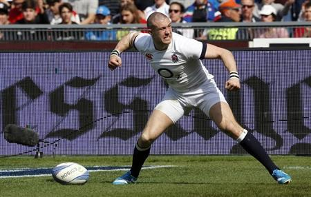 England's Mike Brown celebrates after scoring during their Six Nations rugby union match against Italy at the Olympic Stadium in Rome
