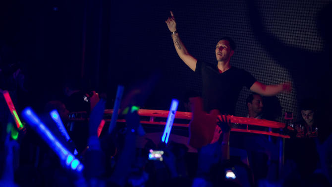 DJ Cedric Gervais performs for revelers at the Surrender nightclub in Las Vegas on Sunday, Jan. 20, 2013. (AP Photo/Julie Jacobson)