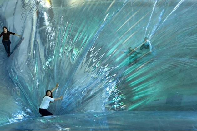 An art installation made adults feel like children again with a large suspended trampoline that gives the impression you're walking on air. The invention of Argentinian artist Tomas Saraceno, the
