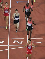 Morocco's Abdalaati Iguider crosses the finish line to win one of the men's 1500 meter semifinals of the athletics competition ahead of Matthew Centrowitz of the US, Nicholas Willis of New Zealand and Silas Kiplagat of Kenya in the Olympic Stadium at the 2012 Summer Olympics, London, Sunday, Aug. 5, 2012. (AP Photo/Mark Duncan)
