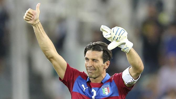 Italy goalkeeper Gianluigi Buffon waves his fan after the 2014 World Cup Group B qualifying soccer match between Italy and Czech Republic at the Juventus stadium in Turin, Italy, Tuesday, Sept. 10, 2013. Italy and Juventus goalkeeper Gianluigi Buffon has equaled Fabio Cannavaro's record of 136 international appearances for the Azzurri. Buffon started the World Cup qualifier against the Czech Republic on Tuesday to match the now retired Cannavaro's number of caps
