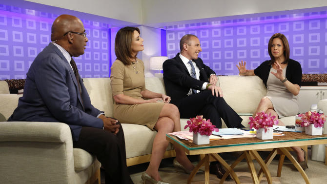 """This image released by NBC shows co-hosts, from left, Al Roker, Savannah Guthrie, and Matt Lauer, talking with weekend correspondent Jenna Wolfe as she announces that she is pregnant during the """"Today"""" show in New York on Wednesday, March 27, 2013. Wolfe, who is expecting a baby in August with her partner, NBC News foreign correspondent Stephanie Gosk, will chronicle her pregnancy experience on a blog. (AP Photo/NBC, Peter Kramer)"""