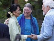 """Myanmar democracy icon Aung San Suu Kyi (L) meets with old friends at a reception at St Hugh's College in Oxford. Suu Kyi made an emotional return to Britain on her 67th birthday Tuesday, visiting her former home of Oxford and speaking of the """"sacrifice"""" her family were forced to make"""