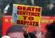 Students and other demonstrators take part in a protest rally in Allahabad, on December 26, 2012, following the rape of a student in the Indian capital on December 16. The student who was left fighting for her life after the incident, was being flown to Singapore for further medical treatment.