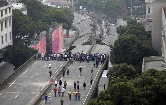 People gather to observe the Perimetral overpass, after its partial demolition as part of Rio's Porto Maravilha urbanisation project, in Rio de Janeiro