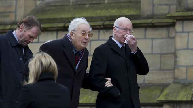 Aston Villa's former chairman Sir Doug Ellis, centre, arrives with former Manchester United and England player Sir Bobby Charlton, right, before a funeral service for the late Sir Tom Finney at Preston Minster, Preston, England, Thursday Feb. 27, 2014. The 91-year-old former England and Preston North End winger died on February 14 and was famous for his loyalty to his league club, Preston North End for whom he made 569 first-class appearances and for his performances in the English national side. AP Photo/Jon Super)