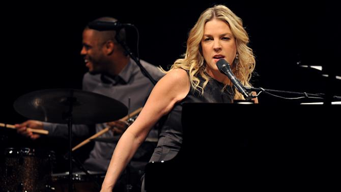 "FILE - In this Nov. 20, 2009 file photo, Canadian jazz pianist and singer Diana Krall performs in Universal Hall in Macedonia's capital Skopje. Krall says she felt reinvigorated making her new CD ""Glad Rag Doll"" which gave her a chance to escape the comfort zone of Great American Songbook standards on which the singer-pianist has built her reputation. (AP Photo/Boris Grdanoski, File)"