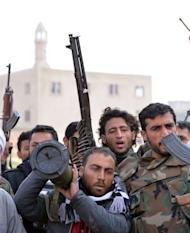 Rebel fighters prepare to fight against Syrian regime forces in the village of Kurnaz, close to the western city of Hama, on January 27, 2013. The United Nations says more than 60,000 people have been killed since the start of the conflict in March 2011.