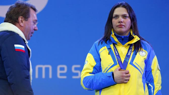 Covering medals, Ukrainians stage silent protest