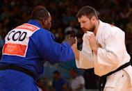 Russia's Alexander Mikhaylin (white) competes with DR Congo's Cedric Mandembo Kebika (blue) during their men's +100kg judo contest match of the London 2012 Olympic Games on August 3, at the ExCel arena in London