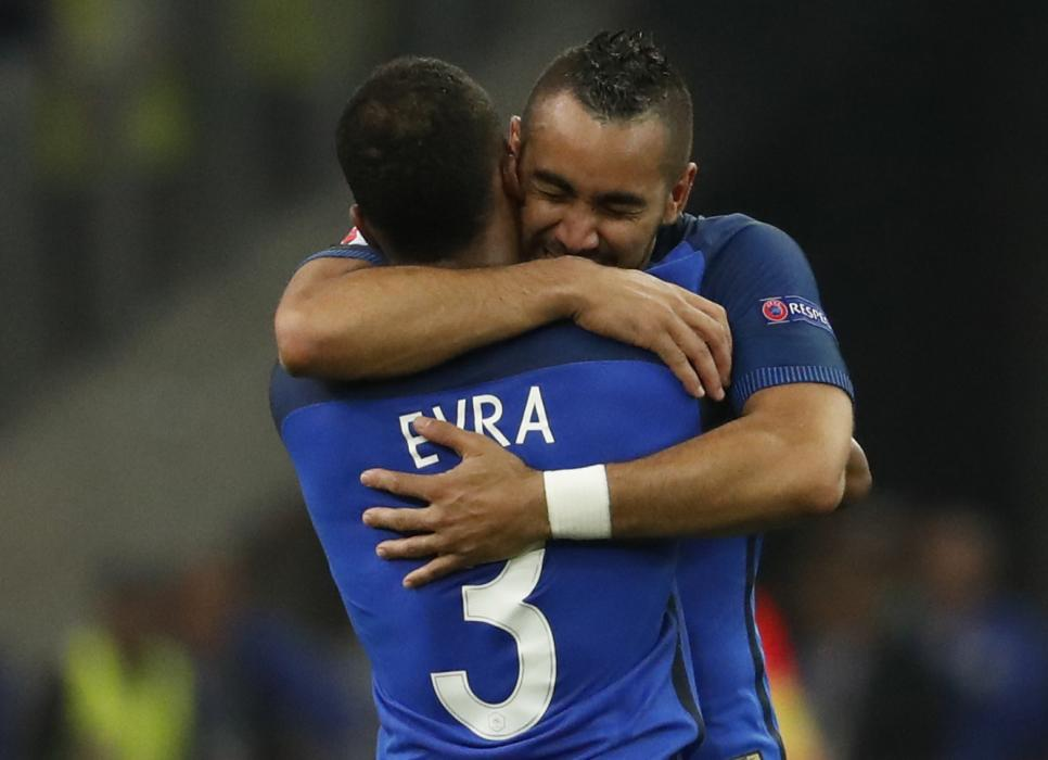 France's Dimitri Payet celebrates with Patrice Evra at the end of the match