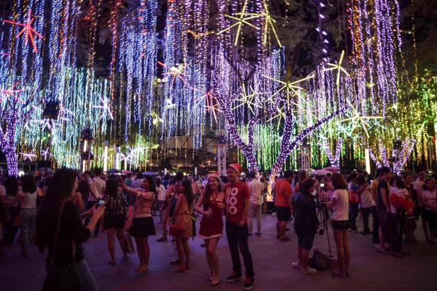 Spectators watch the Festival of Lights displays along a financial district in Makati city, Metro Manila