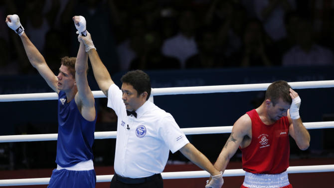 Britain's Luke Campbell (L) is declared the winner over Ireland's John Joe Nevin after their Men's Bantam (56kg) gold medal boxing match at the London Olympics