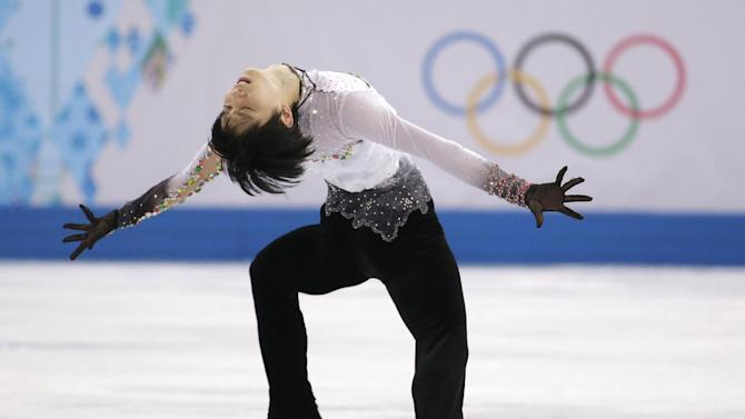 Yuzuru Hanyu of Japan competes in the men's free skate figure skating final at the Iceberg Skating Palace during the 2014 Winter Olympics, Friday, Feb. 14, 2014, in Sochi, Russia