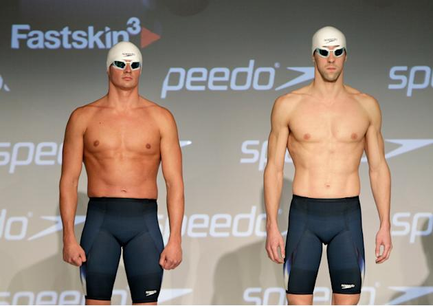 Olympic medalists Ryan Lochte, left, and Michael Phelps model Speedo's new Fastskin 3 swimsuit during a news conference in New York, Wednesday, Nov. 30, 2011. (AP Photo/Kathy Willens)