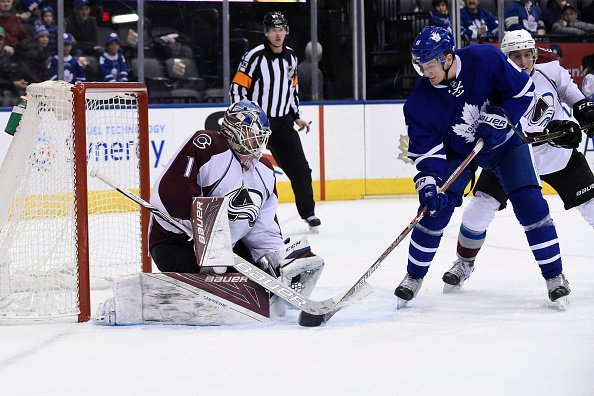 TORONTO, ON - DECEMBER 11: Toronto Maple Leafs Left Wing Zach Hyman (11) tips the puck into the glove of Colorado Avalanche Goalie Semyon Varlamov (1) during the regular season NHL game between the Colorado Avalanche and Toronto Maple Leafs on December 11, 2016 at Air Canada Centre in Toronto, ON. (Photo by Gerry Angus/Icon Sportswire via Getty Images)