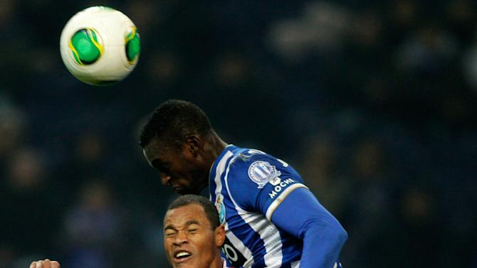 Porto's Jackson jumps for the ball with Braga's Baiano during their Portuguese Premier League soccer match at the Dragao stadium in Porto