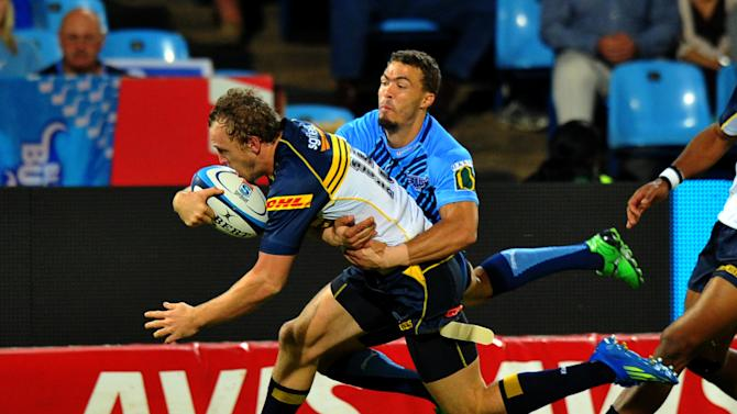 Australia's ACT Brumbies fullback Jesse Mogg (L) is by a South-Africa's Northern Bulls' player during the Super 15 Rugby union match between Northern Bulls and ACT Brumbies at the Loftus Versfeld stadium in Pretoria , on April 21, 2012. AFP PHOTO / ALEXANDER JOE (Photo credit should read ALEXANDER JOE/AFP/Getty Images)
