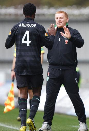 Efe Ambrose, left, celebrates with Celtic manager Neil Lennon after scoring against St Mirren