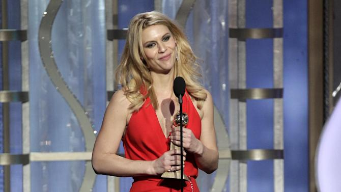 """This image released by NBC shows Claire Danes with her award for best actress in a TV drama series for her role in """"Homeland"""" during the 70th Annual Golden Globe Awards at the Beverly Hilton Hotel on Jan. 13, 2013, in Beverly Hills, Calif. (AP Photo/NBC, Paul Drinkwater)"""