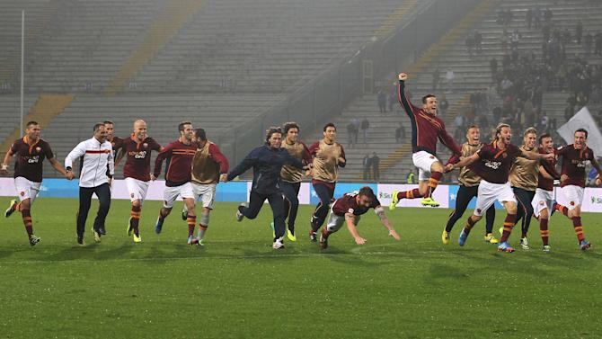 AS Roma players celebrate at the end of the Serie A soccer match between Udinese and Roma, at the Friuli Stadium in Udine, Italy, Sunday, Oct. 27, 2013. Roma won 1 - 0 to keep the lead of the Serie A