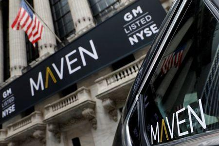 A sign for General Motors Co. car-sharing operation, Maven hangs on the facade of the New York Stock Exchange (NYSE) in New York
